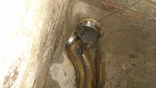 110mm non return valve ratflap being installed in a sewer